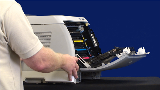 squeeze the white link lever on the left side and then remove the left cover - Hp Color Laserjet 2600n